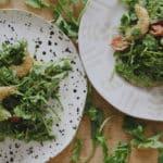 pesto shrimp salad on plates